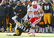 November 23 2012: Nebraska Cornhuskers tight end Ben Cotton (81) tries to spin away from Iowa Hawkeyes linebacker Anthony Hitchens (31) during the first half of the NCAA football game between the Nebraska Cornhuskers and the Iowa Hawkeyes at Kinnick Stadium in Iowa City, Iowa on Friday November 23, 2012. Nebraska defeated Iowa 13-7 in the Heroes Game on Black Friday.