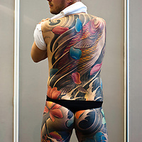 Manchester, UK - 4 August 2012: a tattooed man poses for some pictures during the Manchester Tattoo Show, one of the most popular conventions of the UK tattoo community.
