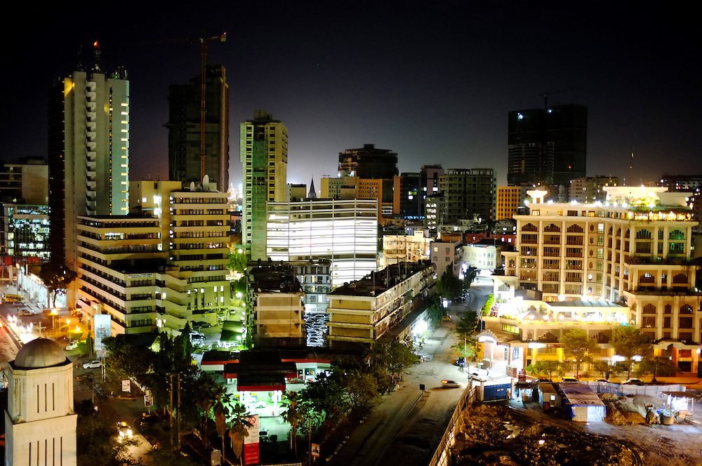 DAR ES SALAAM, TANZANIA - 13-08-22 -  Downtown Dar es Salaam at night on August 22. A new high-rise is being constructed at bottom right. Dar es Salaam is one of Africa's fastest growing cities. Photo by Daniel Hayduk
