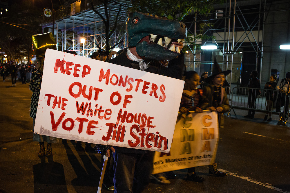 "New York, NY - 31 October 2016. A man in a monster costume carries a sign that reads ""Keep monsters out of the White House vote Jill Stein"" in the annual Greenwich Village Halloween parade. Stein is running as a Green Party candidate."