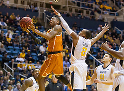 Jan 20, 2016; Morgantown, WV, USA; Texas Longhorns guard Kerwin Roach Jr. (12) shoots under the basket while being defended by West Virginia Mountaineers guard Jevon Carter (2) during the first half at the WVU Coliseum. Mandatory Credit: Ben Queen-USA TODAY Sports