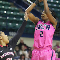 UNCW's Brie Mobley shoots over Northeastern's Tanish Hopewell Sunday February 15, 2015 at Trask Coliseum. (Jason A. Frizzelle)