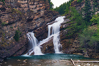 Cameron Falls is a very famous, beautiful and serene waterfall in Waterton Lakes National Park in southern Alberta, Canada where Cameron Creek cascades over one-and-a-half billion year-old Precambrian bedrock.