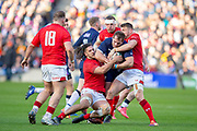 Fraser Brown (#16) of Scotland is tackled by Josh Navidi (#6) and Dan Biggar (#22) of Wales during the Guinness Six Nations match between Scotland and Wales at BT Murrayfield Stadium, Edinburgh, Scotland on 9 March 2019.