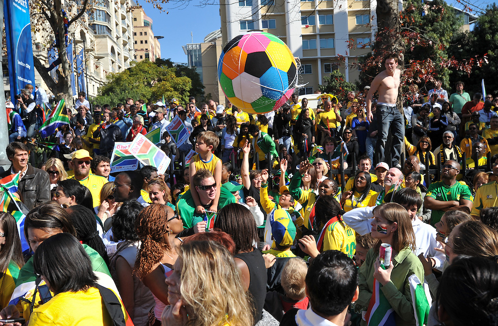 """A multi-colored soccer ball is tossed above the crowd at the """"United We Shall Stand"""" rally for the South African national soccer team, Bafana Bafana, Tuesday, June 9, 2010 in Johannesburg, South Africa. South Africa is hosting the FIFA World Cup, which begins June 11. Photo by Bahram Mark Sobhani"""