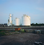 An industrial plant next to the river Mersey at the Stanlow oil refinery at Ellesmere Port in Cheshire. The Mersey is a river in north west England which stretches for 70 miles (112 km) from Stockport, Greater Manchester, ending at Liverpool Bay, Merseyside. For centuries, it formed part of the ancient county divide between Lancashire and Cheshire.