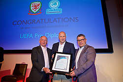 NEWPORT, WALES - Friday, May 18, 2018: Cameron Toshack receives his UEFA Pro Licence Diploma from Lennie Lawrence (left) and Wales technical director Osian Roberts (right) during day one of the Football Association of Wales' National Coaches Conference 2018 at the Celtic Manor Resort. (Pic by David Rawcliffe/Propaganda)