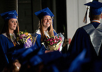 Vice President Allison Daigle, Treasurer Courtney Leach with President Brendon Murphy prepare to present the class gifts during the Gilford High School Commencement Exercises held Saturday morning at Meadowbrook Pavilion.  (Karen Bobotas/for the Laconia Daily Sun)