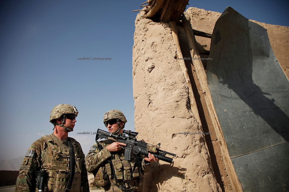 US soldiers try to localize man suspected to trigger an IED before which hit a US-Army vehicle.  A Route Clearance Package patrols to identify hidden IED´s along a certain road.