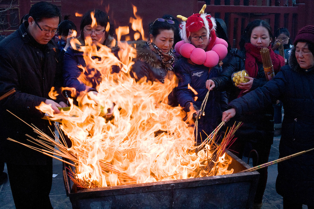 Beijingers and Chinese travelling for the New Year were thousands queuing to enter into the Lamas Temple (the main buddihst temple of the capital) in order to make incens offering to get luck and good fortune for the important New Year of the Dragon, 2012, january 23 evening..