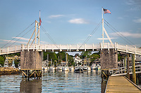 The walking bridge over Perkins Cove in Ogunquit stands tall on a calm and clear summer morning.