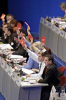 18 NOV 2003, BOCHUM/GERMANY:<br /> Olaf Scholz (2.v.R.), SPD Generalsekretaer, und Gerhard Schroeder (R), SPD, Bundeskanzler, mit Stimmkarten, waehrend einer Abstmmung, SPD Bundesparteitag, Ruhr-Congress-Zentrum<br /> IMAGE: 20031119-01-063<br /> KEYWORDS: Gerhard Schröder, Parteitag, party congress, Stimmkarte