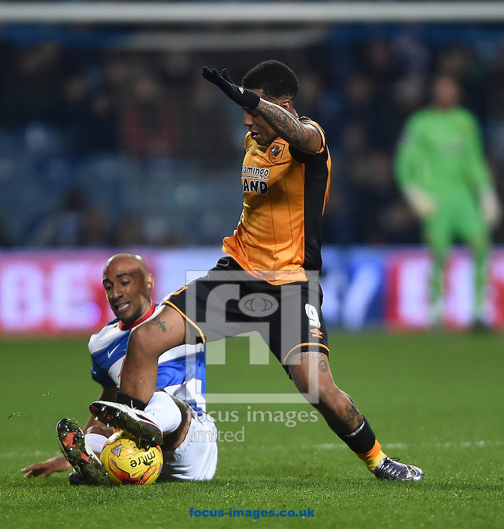 Hull City's Abel Hernandez (right) and Queens Park Rangers' Karl Henry during the Sky Bet Championship match at the Loftus Road Stadium, London<br /> Picture by Daniel Hambury/Focus Images Ltd +44 7813 022858<br /> 01/01/2016