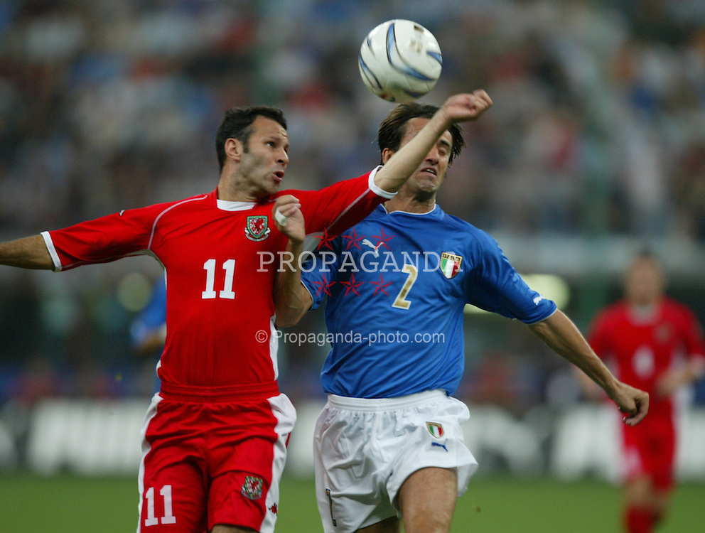 MILAN, ITALY - Saturday, September 6, 2003: Wales' Ryan Giggs and Italy's Christian Panucci during the Euro 2004 qualifying match at the San Siro Stadium. (Pic by David Rawcliffe/Propaganda)