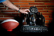 Former Chicago Cardinals football player Charley Trippi was inducted into the College Football Hall of Fame and the Pro Football Hall of Fame during his career in the sport. He touches a trophy made of coal that came from his hometown in Pennsylvania. Seen in his Athens, Georgia home. KENDRICK BRINSON