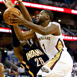 Oct 30, 2013; New Orleans, LA, USA; New Orleans Pelicans point guard Tyreke Evans (1) shoots over Indiana Pacers center Ian Mahinmi (28) during the second half of a game at New Orleans Arena. The Pacers defeated the Pelicans 95-90. Mandatory Credit: Derick E. Hingle-USA TODAY Sports