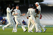 Wicket - Joe Denly of England is mobbed after a spectacular catch to remove Tim Paine of Australia off the bowling of Jofra Archer of England during the International Test Match 2019 match between England and Australia at Lord's Cricket Ground, St John's Wood, United Kingdom on 18 August 2019.
