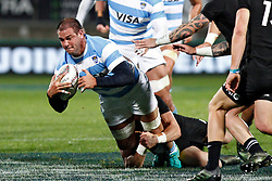 Argentina's Benjamin Macome, left, goes to ground in a tackle against New Zealand in the Investic Rugby Championship Test match at Yarrow Stadium, New Plymouth, New Zealand, Saturday, September 09, 2017. Credit:SNPA / Dean Pemberton  **NO ARCHIVING**