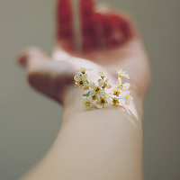 small flowers over a girl's arm