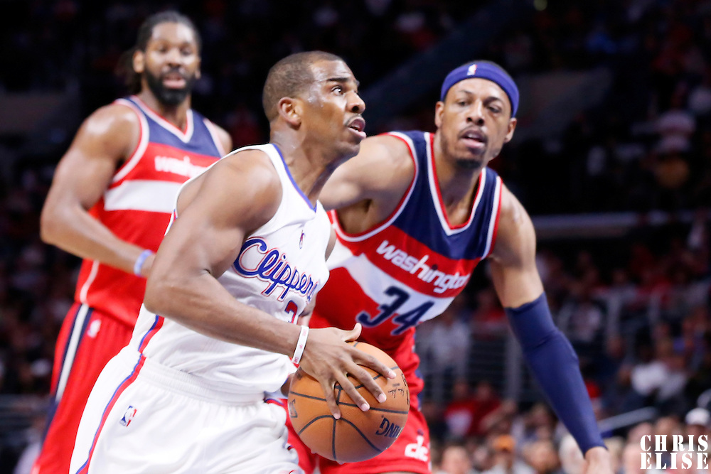 20 March 2015: Los Angeles Clippers guard Chris Paul (3) drives past Washington Wizards forward Paul Pierce (34) during the Los Angeles Clippers 113-99 victory over the Washington Wizards, at the Staples Center, Los Angeles, California, USA.