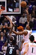 Jan 30, 2017; Phoenix, AZ, USA; Phoenix Suns forward Marquese Chriss (0) lays up the ball against Memphis Grizzlies forward Zach Randolph (50) in the first half of the NBA game at Talking Stick Resort Arena. Mandatory Credit: Jennifer Stewart-USA TODAY Sports
