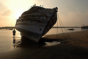 India..Nagapattinam fishing harbour on the East Coast. Tamil Nadu state. Boats washed ashore and damaged by the tsunami of 26.12.2005