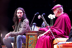 © Licensed to London News Pictures. 16/06/2012. Manchester , UK . Russell Brand and The Dalai Lama at the Manchester Arena , Greater Manchester , at the Stand Up and Be the Change youth event . The Dalai Lama is on a 10 day tour of the UK . Photo credit : Joel Goodman/LNP