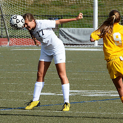 O'Hara's Gina Amororso (17) heads the ball in front of Upper Darby's Jess Liberio (9) during the first half of the Upper Darby at Cardinal O'Hara girls soccer game, Wednesday September 3, 2014.  (Times staff / TOM KELLY IV)