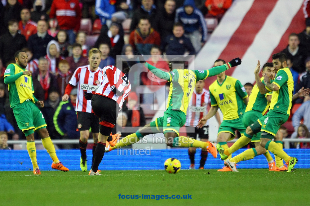 Picture by Paul Chesterton/Focus Images Ltd +44 7904 640267<br /> 21/12/2013<br /> Sunderland's Ki Sung-Yueng has a shot on goal during the Barclays Premier League match at the Stadium Of Light, Sunderland.