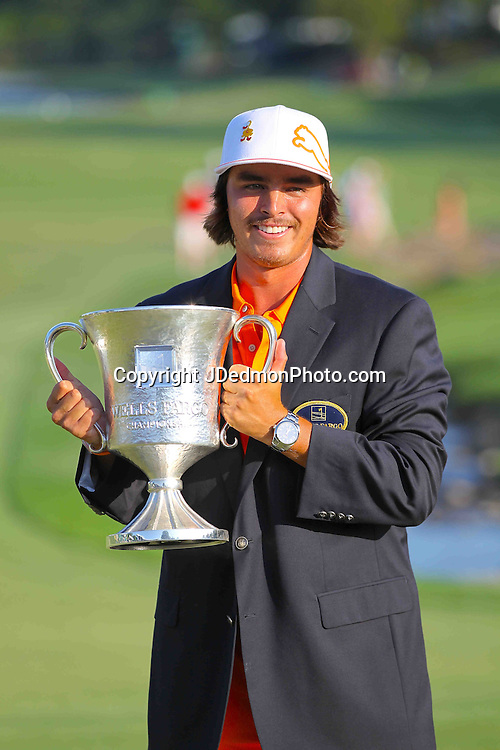 06 May 2012: Rickie Fowler and trophy during final round action at the the Wells Fargo Tournament at Quail Hollow Country Club, Charlotte, North Carolina. Rickie Fowler wins the tournament in a three-way playoff again D.A. Points and Rory McIlroy.