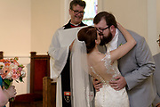 bride and groom first kiss wedding photo