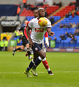 Bolton Defender, Prince-D?sir Gouano controls the ball well to take it away to safety during the Sky Bet Championship match between Bolton Wanderers and Bristol City at the Macron Stadium, Bolton, England on 7 November 2015. Photo by Mark Pollitt.