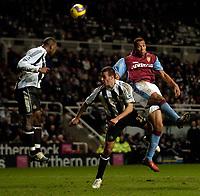 Photo: Jed Wee.<br /> Newcastle United v Aston Villa. The Barclays Premiership. 31/01/2007.<br /> <br /> Aston Villa's John Carew (R) floats a header towards goal.