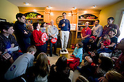 Republican presidential hopeful Mitt Romney talks to supporters at the Cook residence on New Years day.