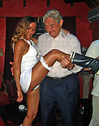**EXCLUSIVE**.George Soros dancing with an exotic dancer, Mimi on top of a table at a Restaurant..St. Barth, Caribbean.Friday, December 21, 2007 .Photo By Celebrityvibe.com.To license this image please call (212) 410 5354; or.Email: celebrityvibe@gmail.com ;.website: www.celebrityvibe.com