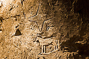 Carvings on walls of caves of Taittinger Champagne in Reims, Champagne-Ardenne, France