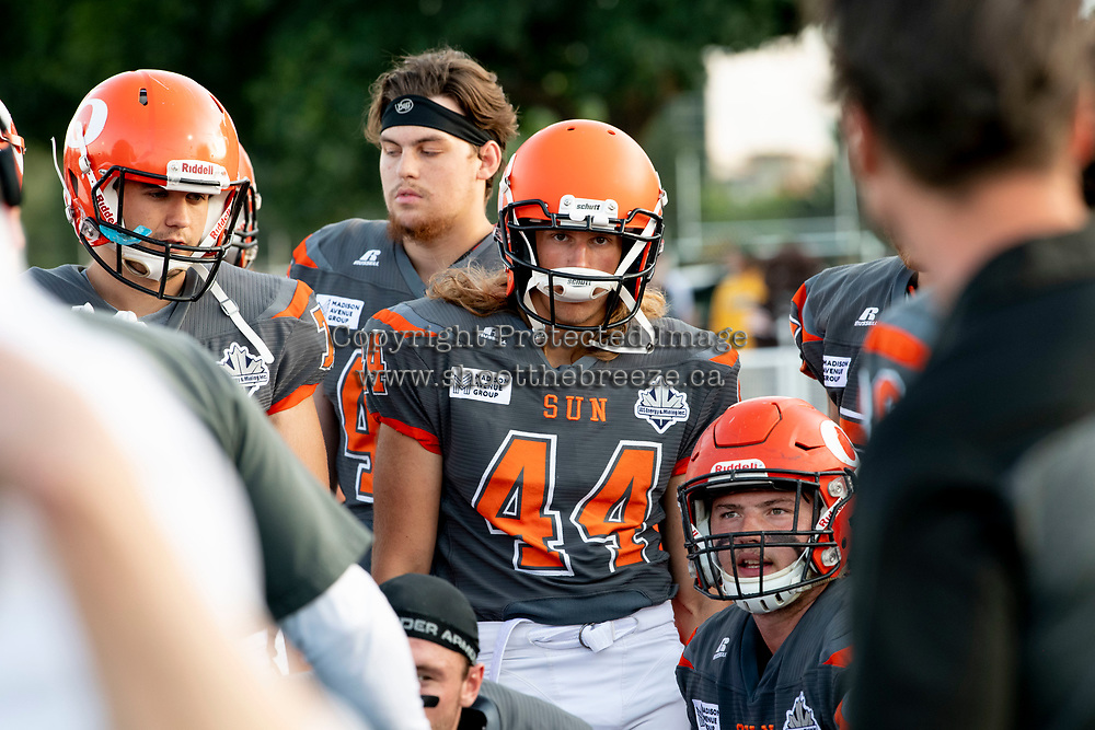 KELOWNA, BC - AUGUST 3:  Gabe Loster #44 and Aiden Hennessey #45 of the Okanagan Sun stand on the sidelines against the Kamloops Broncos at the Apple Bowl on August 3, 2019 in Kelowna, Canada. (Photo by Marissa Baecker/Shoot the Breeze)