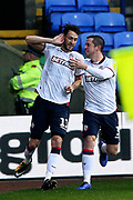 Bolton Wanderers midfielder Will Buckley (11) scores a goal 1-0 and celebrates during the EFL Sky Bet Championship match between Bolton Wanderers and Wigan Athletic at the Macron Stadium, Bolton, England on 1 December 2018.
