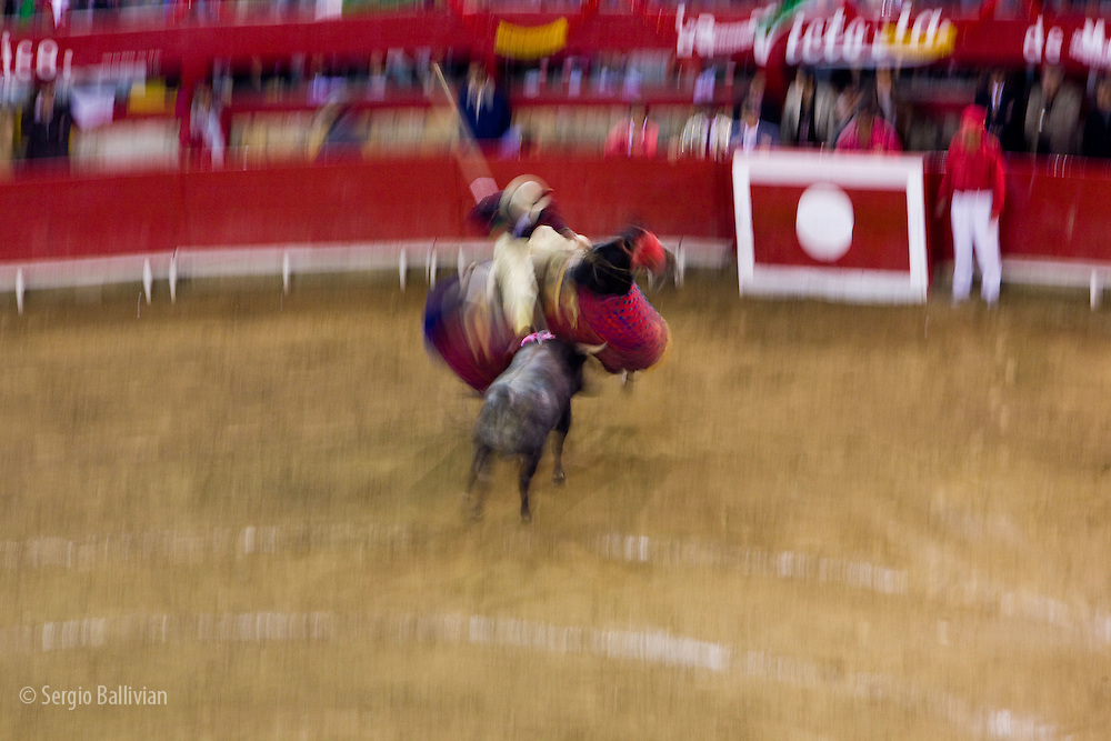 A bull charges a Picador as he is being prepared for the bullfighter in the Plaza de Toros in Morelia, Mexico.