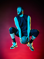 one basketball player man Isolated on black background