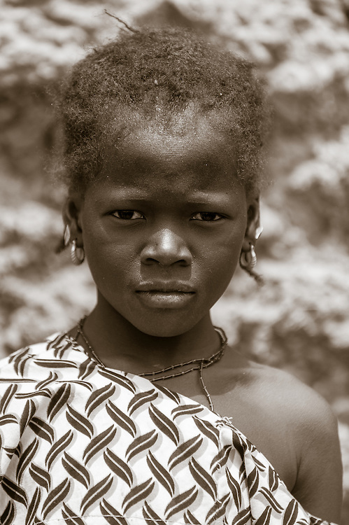 Portrait of a young Fulani girl in a local market in northern Burkina Faso. The Fulani or Peul are nomadic herdsmen of the Sahel region of West Africa.