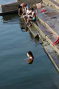 India, Uttar Pradesh, Varanasi Caucasian tourist in the Ganges River