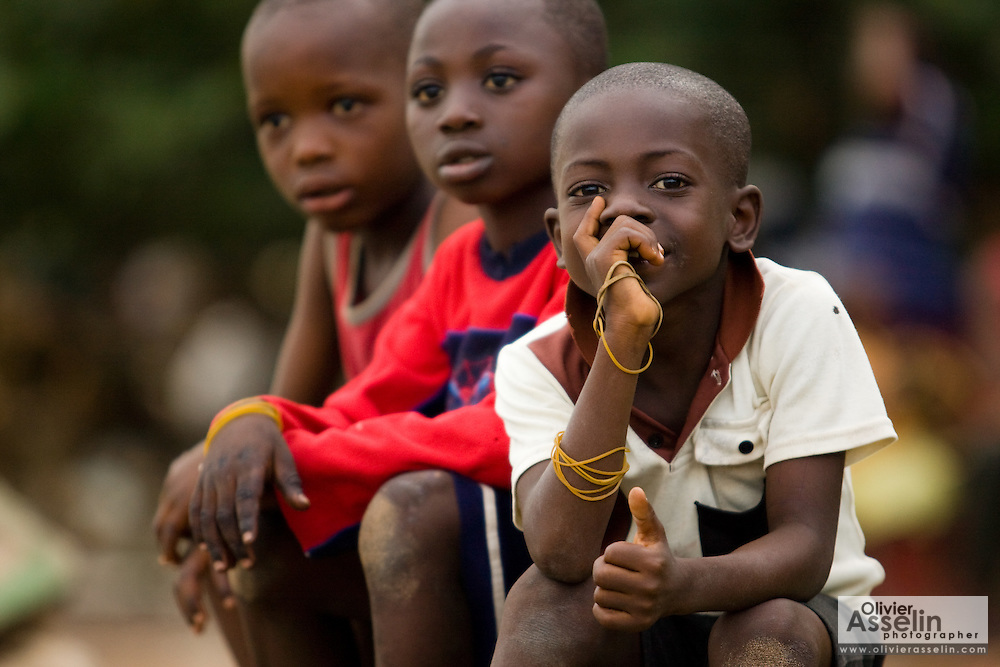 Three boys sit together in Accra, Ghana on Tuesday June 16, 2009.
