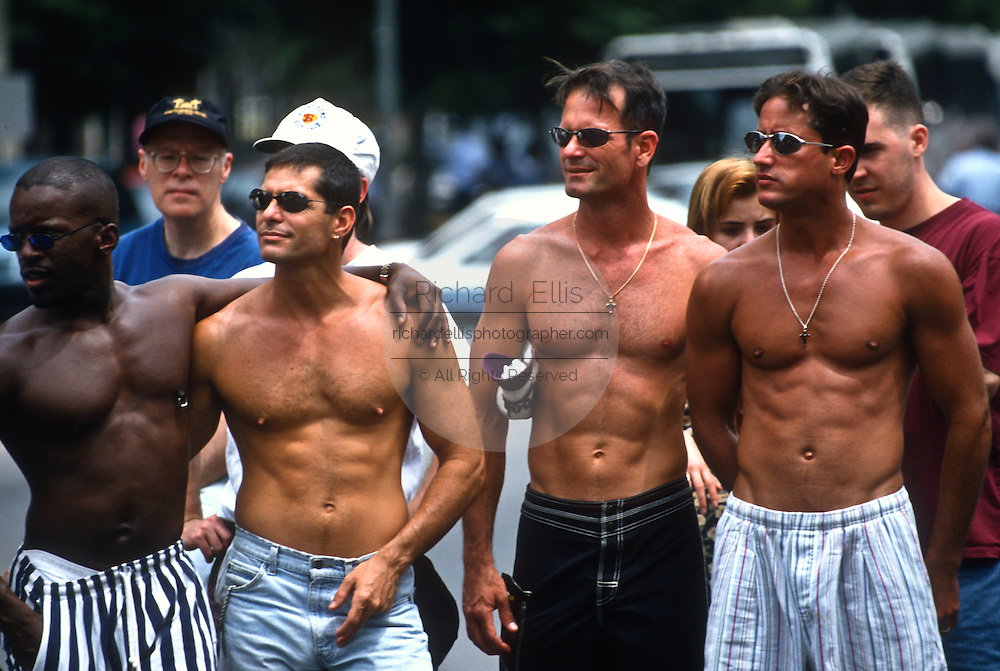 Shirtless men during the Gay and lesbian pride march June 16, 1996 in Washington, DC.