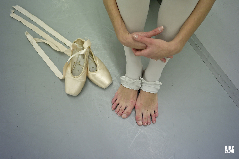 Spanish dancer Isabel Trigo, 20, has been training at the Maria de Avila Ballet School in Zaragoza since she was 7.Detail of ballerina shoes and damaged feet.