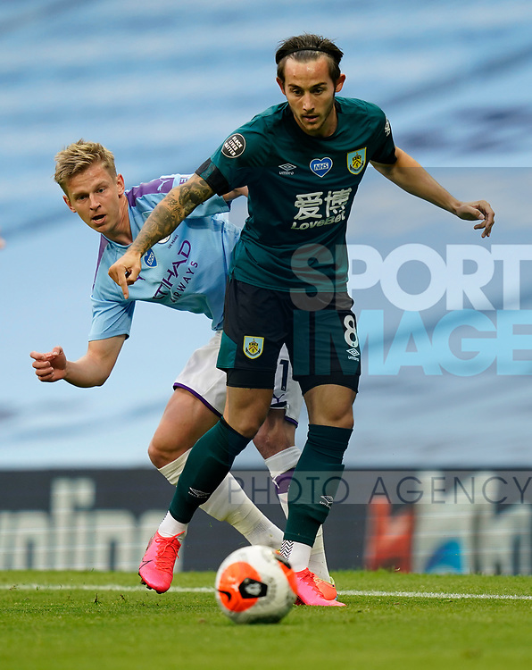 Oleksandr Zinchenko of Manchester City tackles Josh Brownhill of Burnley during the Premier League match at the Etihad Stadium, Manchester. Picture date: 22nd February 2020. Picture credit should read: Andrew Yates/Sportimage
