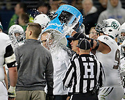 Northwest Missouri head coach Adam Dorrel gets dunked with water by Northwest Missouri defensive end Marcus Stewart Jr. (97) late in the second half of the NCAA Division II Championship football game against Shepherd, Saturday, Dec. 19, 2015, in Kansas City, Kan. Missouri defeated Shepherd 34-7. (AP Photo/Colin E. Braley)