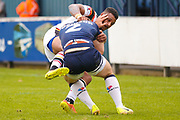 Bradford Bulls winger Johnny Campbell (19) tackles Swinton Lions Shaun Robinson (2)  during the Kingstone Press Championship match between Swinton Lions and Bradford Bulls at the Willows, Salford, United Kingdom on 20 August 2017. Photo by Simon Davies.