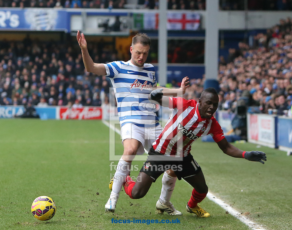 Clint Hill of Queens Park Rangers and Sadio Mane of Southampton during the Barclays Premier League match at the Loftus Road Stadium, London<br /> Picture by John Rainford/Focus Images Ltd +44 7506 538356<br /> 07/02/2015