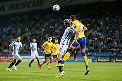 Jonathan Stead of Huddersfield and Rob Kiernan of Wigan compete in the air - Photo mandatory by-line: Rogan Thomson/JMP - 07966 386802 - 16/09/2014 - SPORT - FOOTBALL - Huddersfield, England - The John Smith's Stadium - Huddersfield Town v Wigan Athletic - Sky Bet Championship.